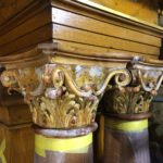 Column capitals during gilding restoration process at St. Cantius Church in Chicago
