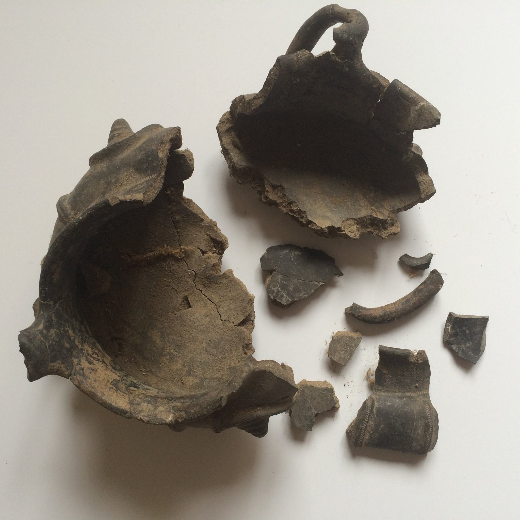 Shattered Etruscan pottery before restoration