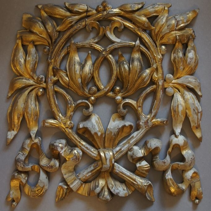 Full view of wooden ornament before gilding restoration
