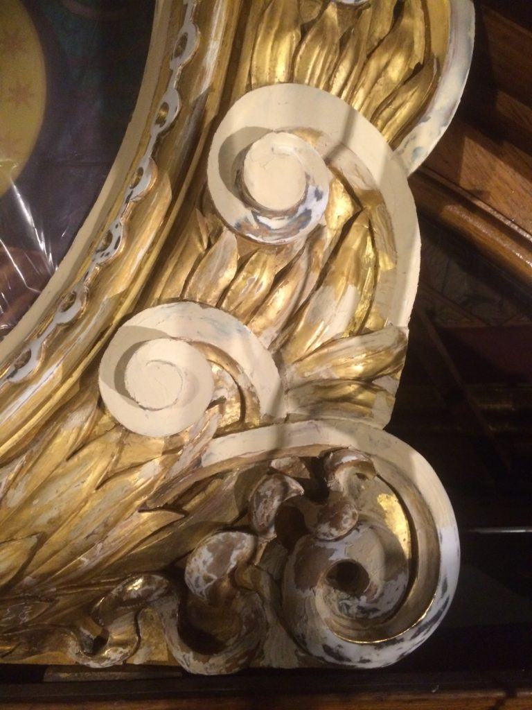Damaged wooden ornament during gilding conservation